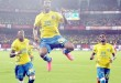 Kochi: Kerala Blasters FC players celebrate after  scoring a goal during their Indian Super League (ISL) match against North East United FC in Kochi on Tuesday.PTI Photo(PTI10_6_2015_000295B)