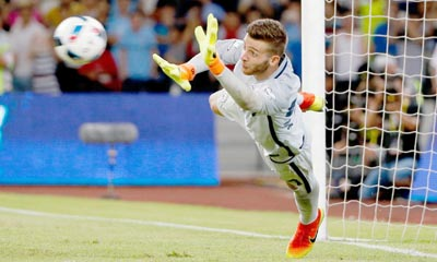 Angus Gunn makes a save during the shootout as Manchester City won 6-5 on penalties.
