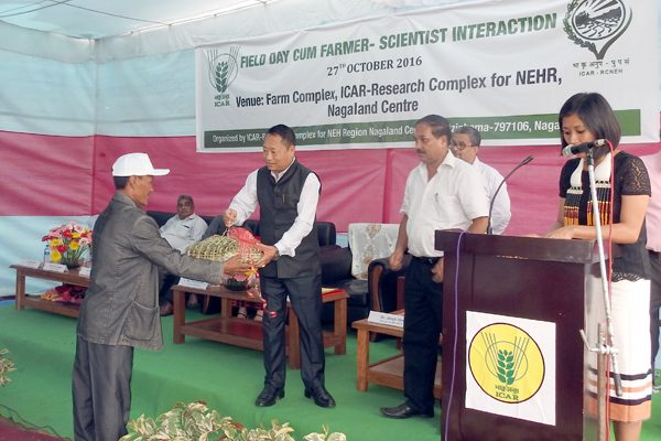 Parliamentary Secretary, Dr. Benjongliba Aier, felicitating farmer at the Field Day cum Farmer- Scientist Interaction at ICAR Research Complex, Medziphema, on October 27.