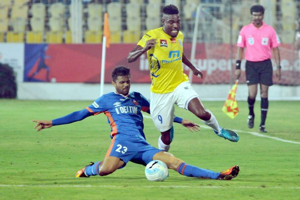 Players of Kerala Blasters FC ( Yellow Jersey) and FC Goa in action during the match of the Indian Super League ( ISL) 2016 in Fatorda, Goa on Monday.