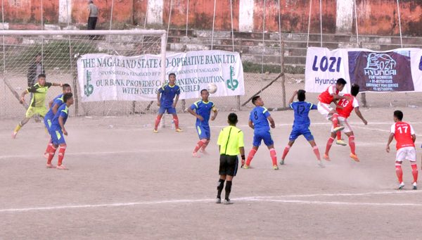 Players of Nagaland Police (blue) and Barak FC seen in action during their match at the Kohima local ground on October 21.