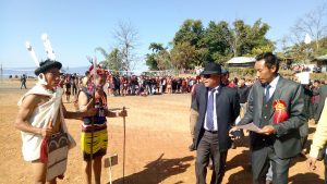 Parliamentary Secretary of Justice & Law and SIRD, Er. Picto Shohe, inspecting a traditional couple wear competition during 40th ARSU general conference in Emlomi village on January 5.