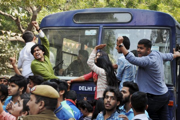 New Delhi: Police detaining ABVP activists after their clash with AISA students at Delhi University in Delhi on Wednesday. PTI Photo(PTI2_22_2017_000196B)