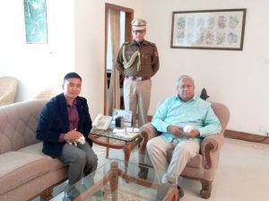 Governor PB Acharya with Assistant Conservator of Forest for Dimapur district, Obed Bohovi Swu, left, on February 24 at the Raj Bhavan in Kohima.
