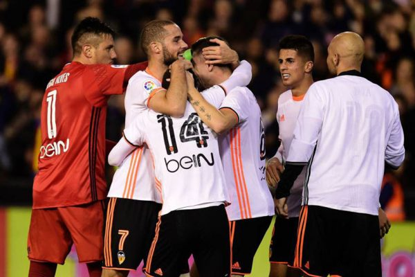 Valencia celebrate their win over Real Madrid.